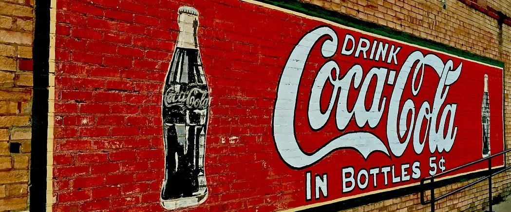 Drink Coca Cola in Bottles wall ad - Food Packaging and Advertising